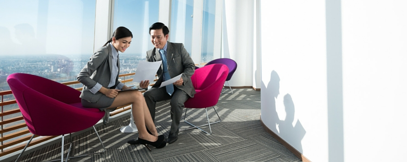 two people discussing work beside window - SingSaver