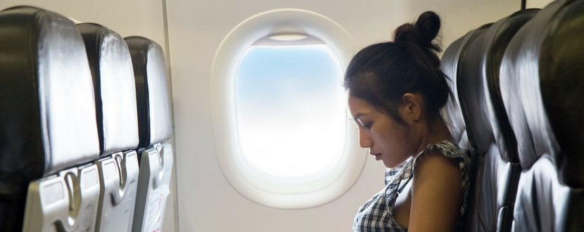 lady sitting in an airplane during flight