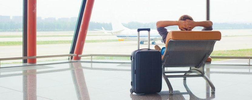 man relaxing in an airport lounge - SingSaver