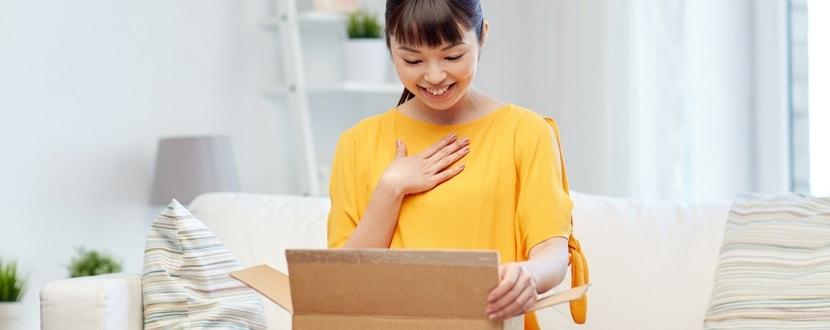 happy lady opening a box