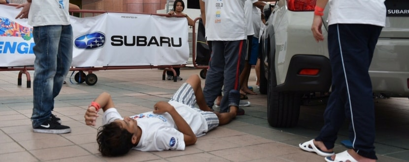 A contestant collapses at last year's Subaru Palm Challenge. Photo source: Channel News Asia