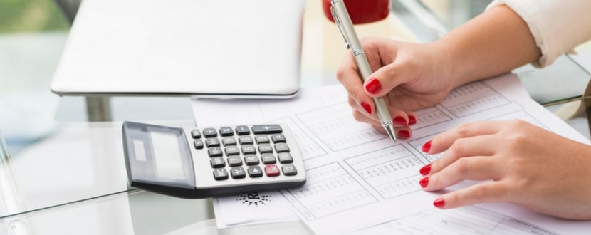 lady measuring financial statement with calculator