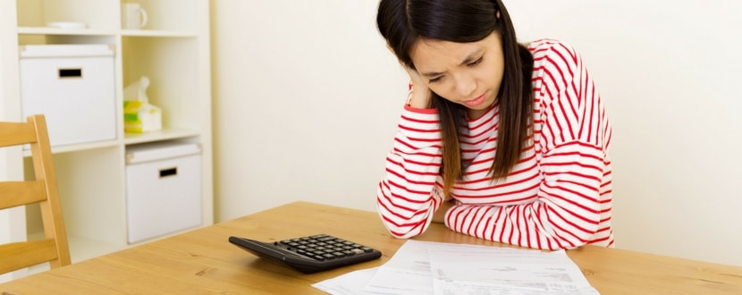 woman troubled over loan repayments