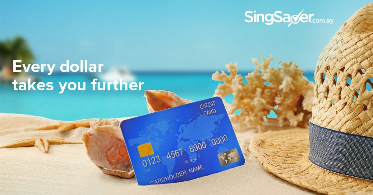 credit card displayed on a sand beach