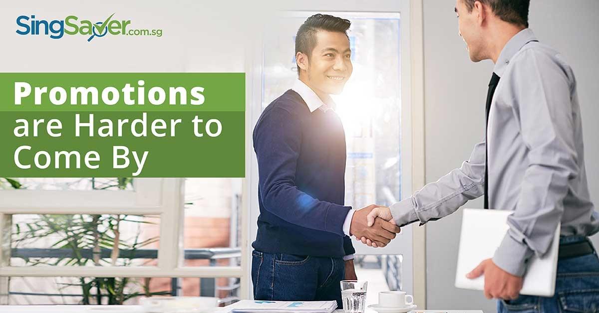 2 men shake hands in office