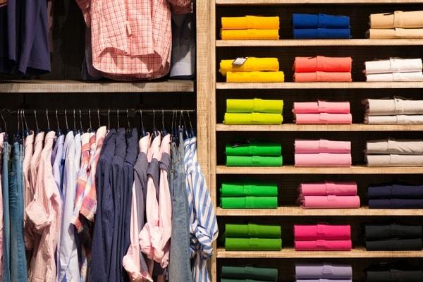 men clothes arranged in wardrobe