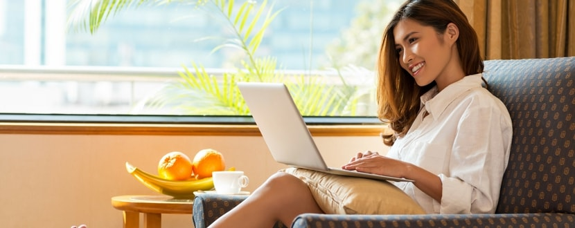woman-using-laptop-min