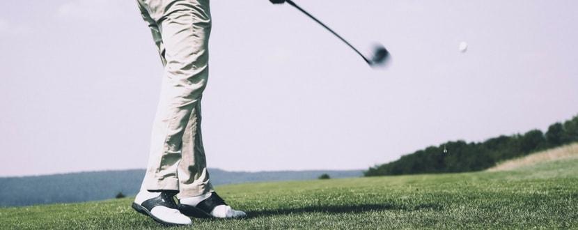 Man tee off golf shot - SingSaver