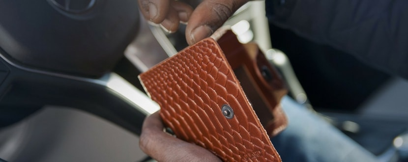 man with brown wallet - SingSaver