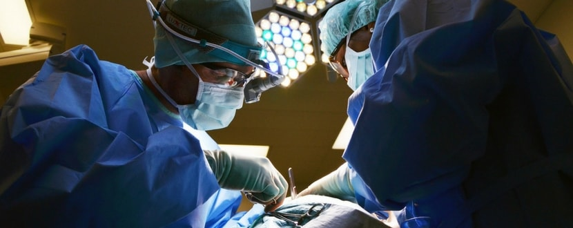 surgeons carrying out an operation - SingSaver
