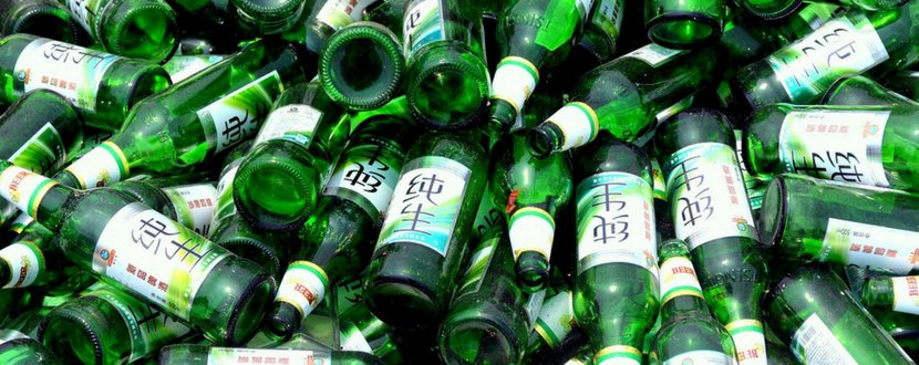 glass bottles piled on to be recycled - SingSaver