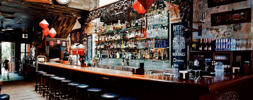 bar with display of alcoholic bottles  - SingSaver