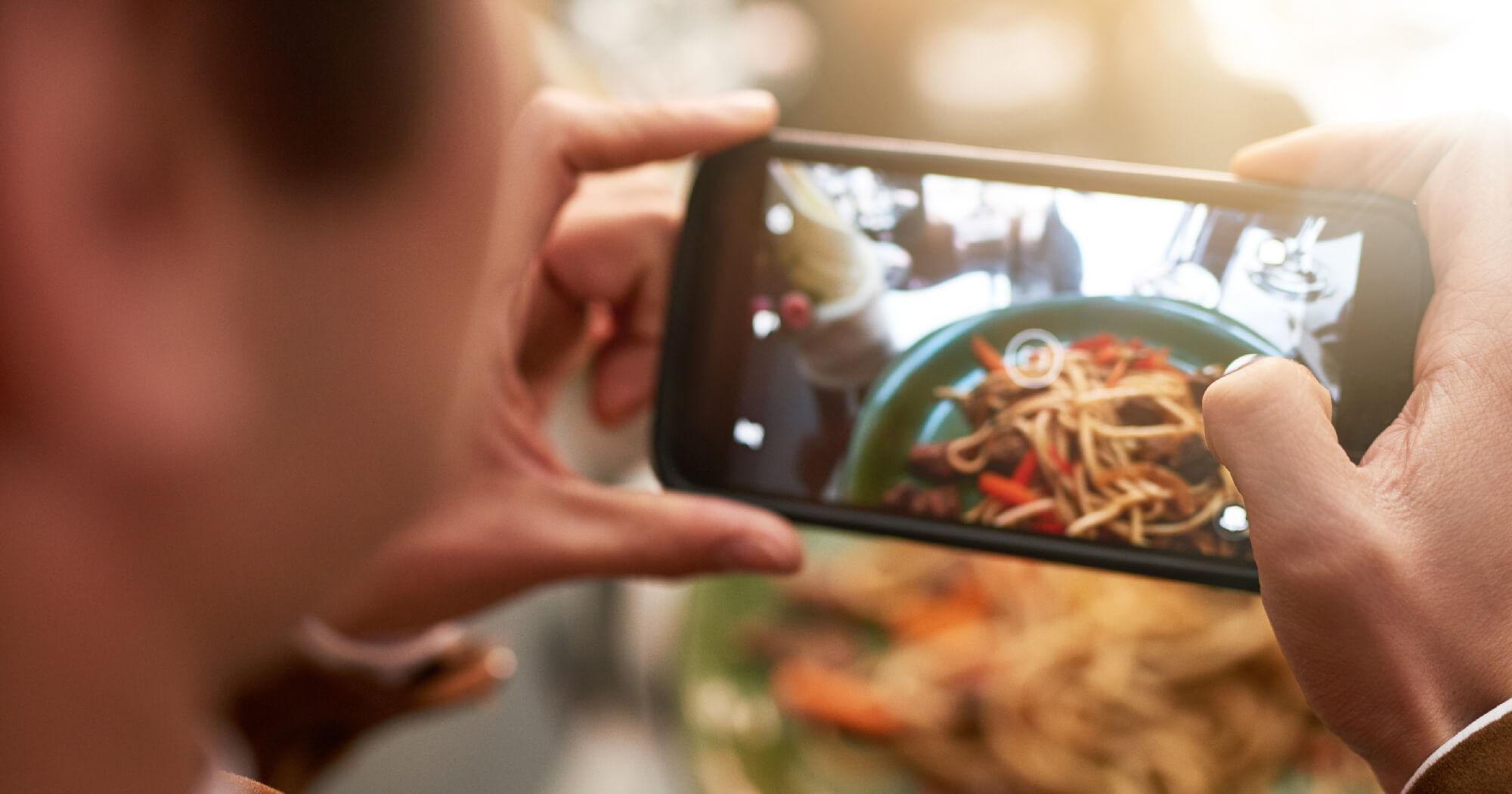 Foodie taking photos of food