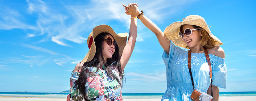 2 ladies having a good time by the beach - SingSaver
