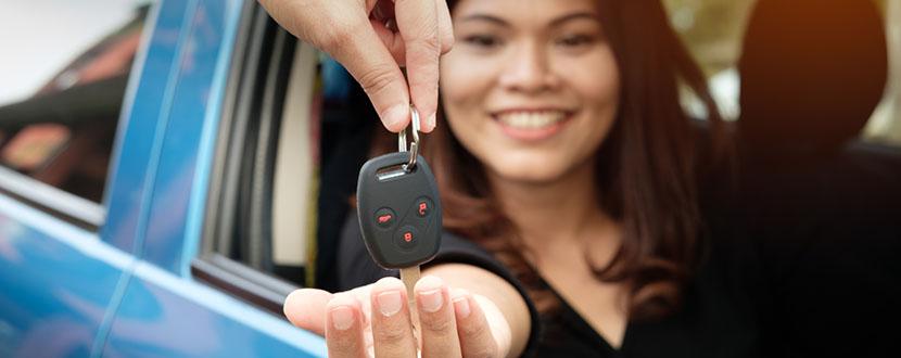 lady getting her new set of car keys -SingSaver