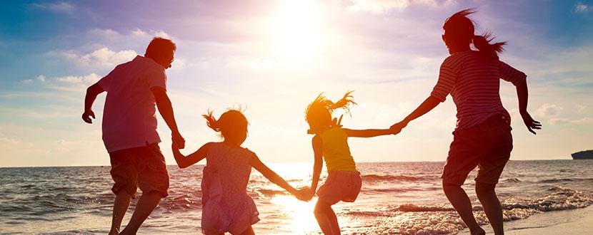 family of 4 enjoying on the beach -SingSaver