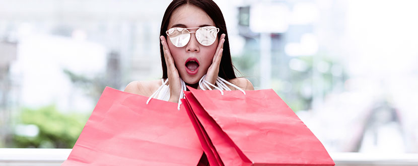 woman shocked with shopping bags -SingSaver