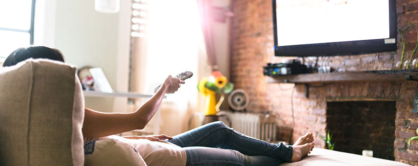 relaxed person watching television -SingSaver