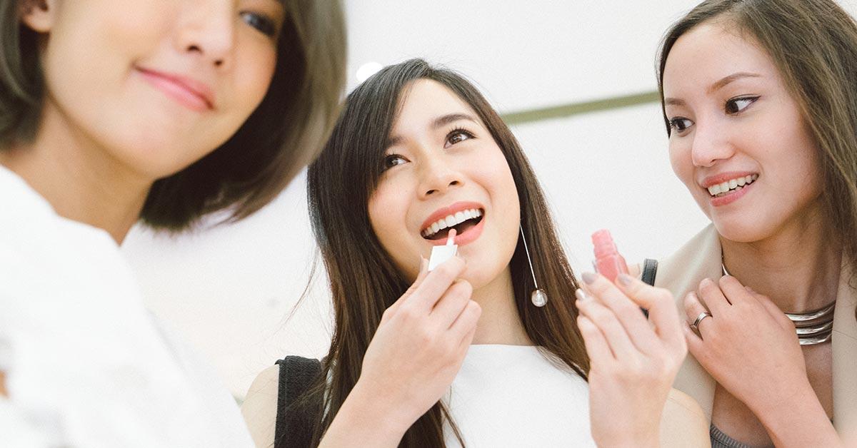 Three ladies applying make up - SingSaver